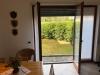 sala-cucina-con-uscita-sul-giardino